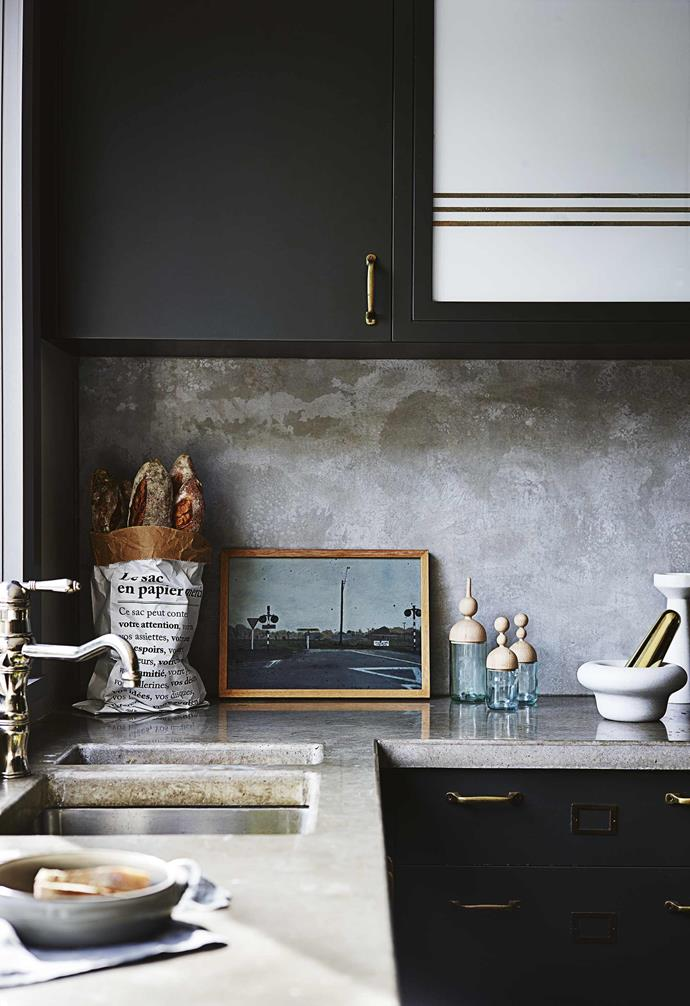 **Kitchen** The mix of brass, concrete and marble forms an elegant look with an industrial twist.