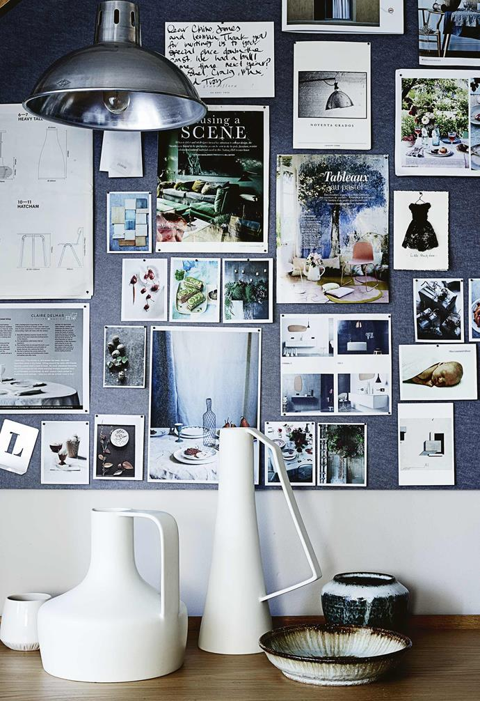"""**Office** On one wall is a custom-built shelving unit from London company Benchmark where personal and business items meet; on another is Claire's inspiration board where she pins up """"anything I need to remember and anything that's going to inspire""""."""