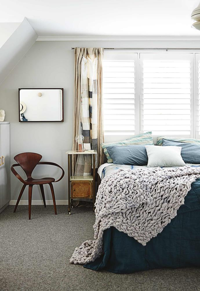 """**Master bedroom** Cosy layers, including an Alison Fraser shibori throw from Small Spaces, dress the bed while a bare [Fred International](https://fredinternational.com.au/