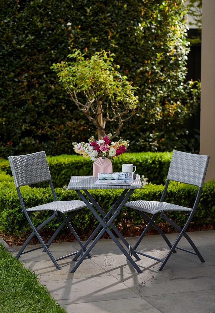 "Outdoor three-piece woven bistro set, $99, [Kmart Online](https://www.kmart.com.au/ target=""_blank"" rel=""nofollow"")."