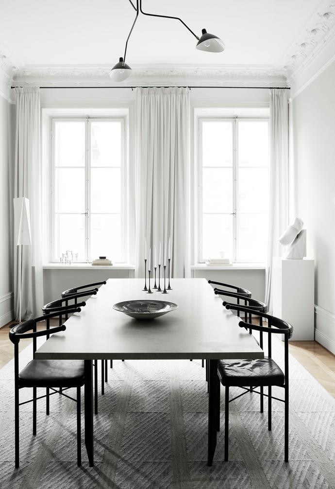"Louise has balanced both light and dark elements in the dining room. The dark [dining table](https://www.homestolove.com.au/10-of-the-best-dining-tables-13249|target=""_blank"") and black chairs ground the space while the tall twin windows draw the eye upwards, with help from the pendant light. It makes the small space feel lightweight, spacious and functional, rather than cramped and heavy."