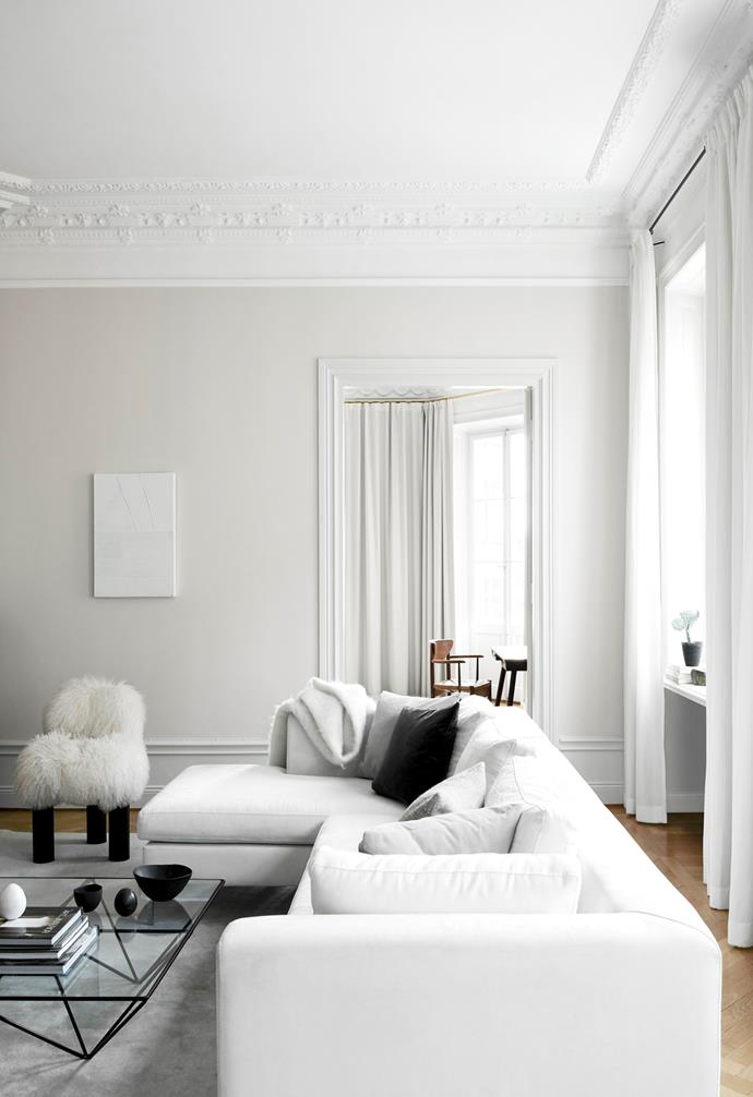 "The [living room](https://www.homestolove.com.au/living-room-essentials-3466|target=""_blank"") is a study in [white-on-white](https://www.homestolove.com.au/beach-boho-this-coastal-home-nails-white-on-white-design-7048