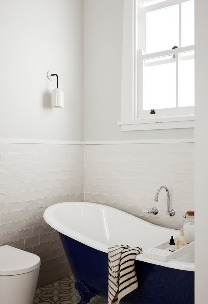 Subway tiles and Astra Walker 'Olde English' tapware bring modern heritage basics to Neil and Sarah's bathroom (right) and allow the heroes to shine. Cue a resplendent navy blue antique slipper bath which makes a classic style statement without hogging the space. Pattern is introduced through enchanting encaustic floor tiles from Jatana Interiors.