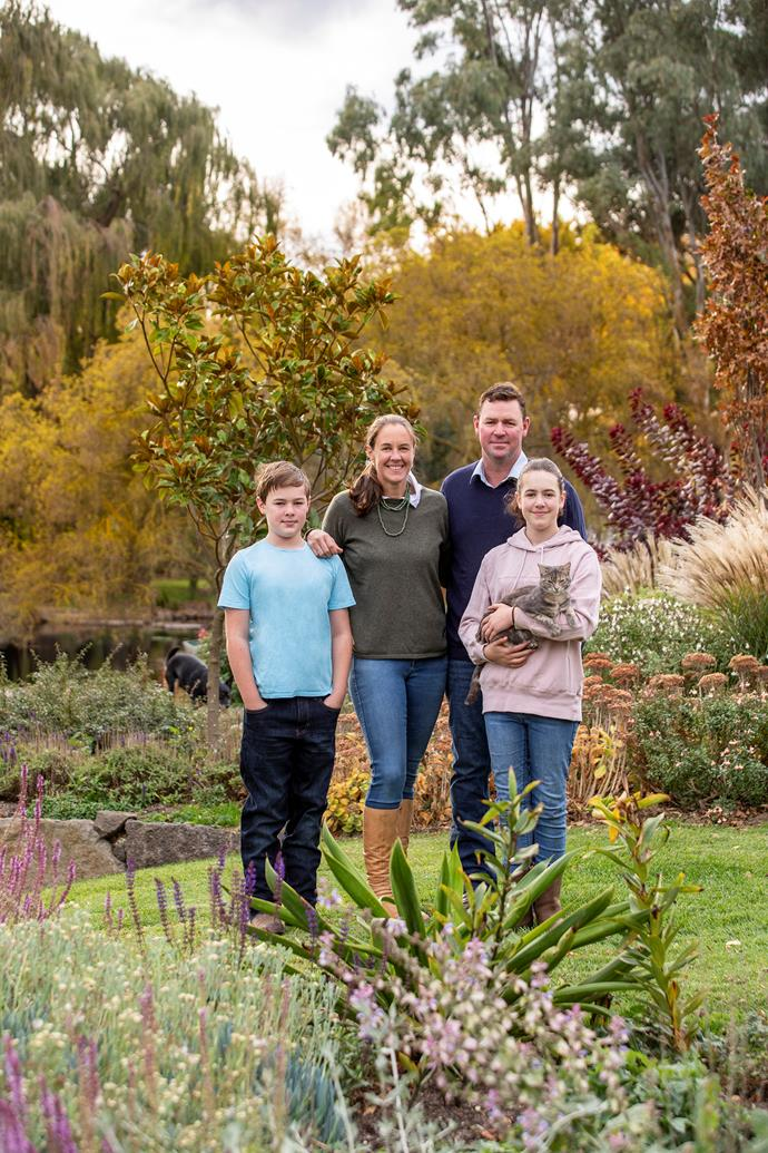 The Crawford family, including, from left, Lachie, 11, Sam, Angus and Emily, 13, with her cat, Athena, all enjoying the results of Sam's handiwork.