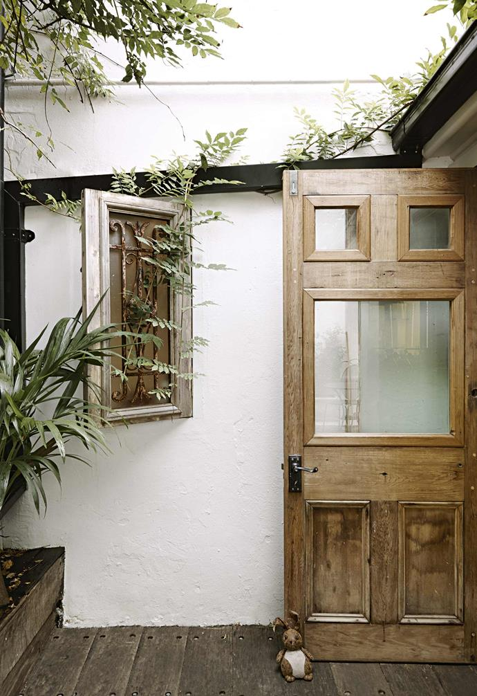 **Outdoors** The bi-fold doors are recycled while the window features both recycled timber and a vintage metal grate.
