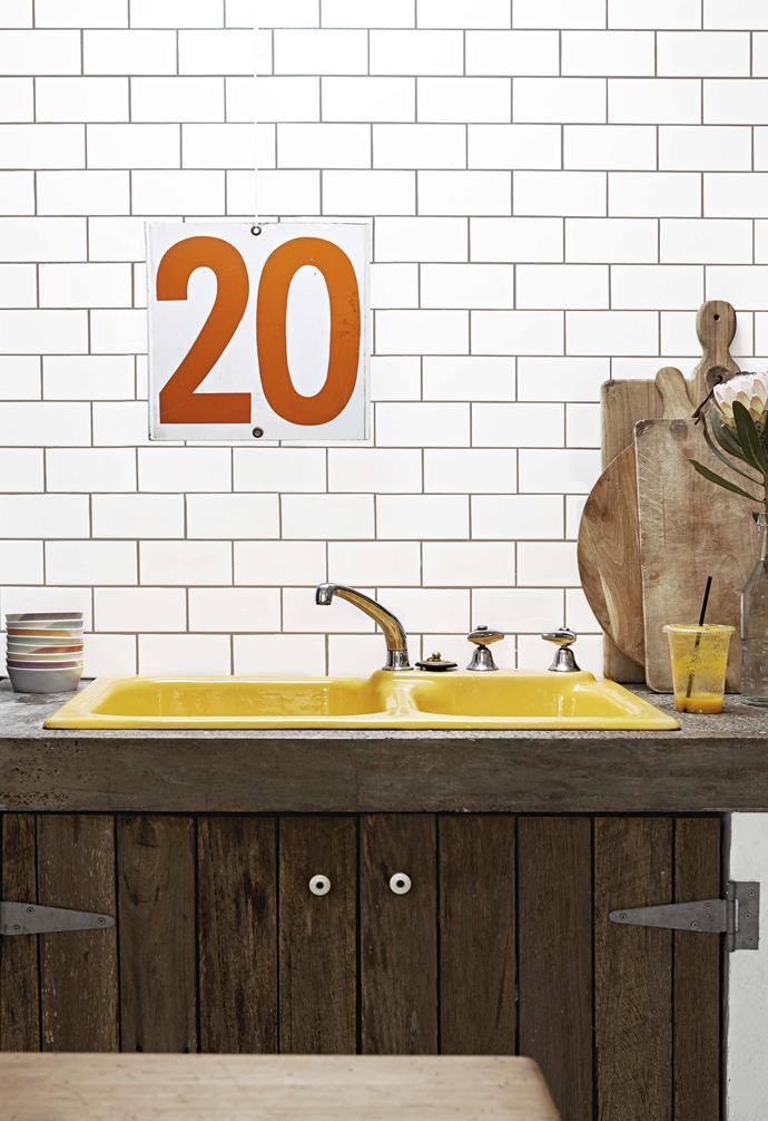 **Kitchen** The vintage yellow sink is a bright touch in the industrial space, contrasting with the recycled timber cupboards.