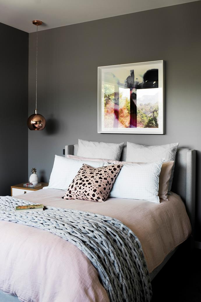 Comfortably bedecked with luxe linen and cushions from Adairs, this cosy and feminine room is the perfect retreat for Melanie and Frank's eldest daughter. A framed artwork from Domayne creates contrast, while copper bedside pendants from Eurolight add a dash of sophistication.