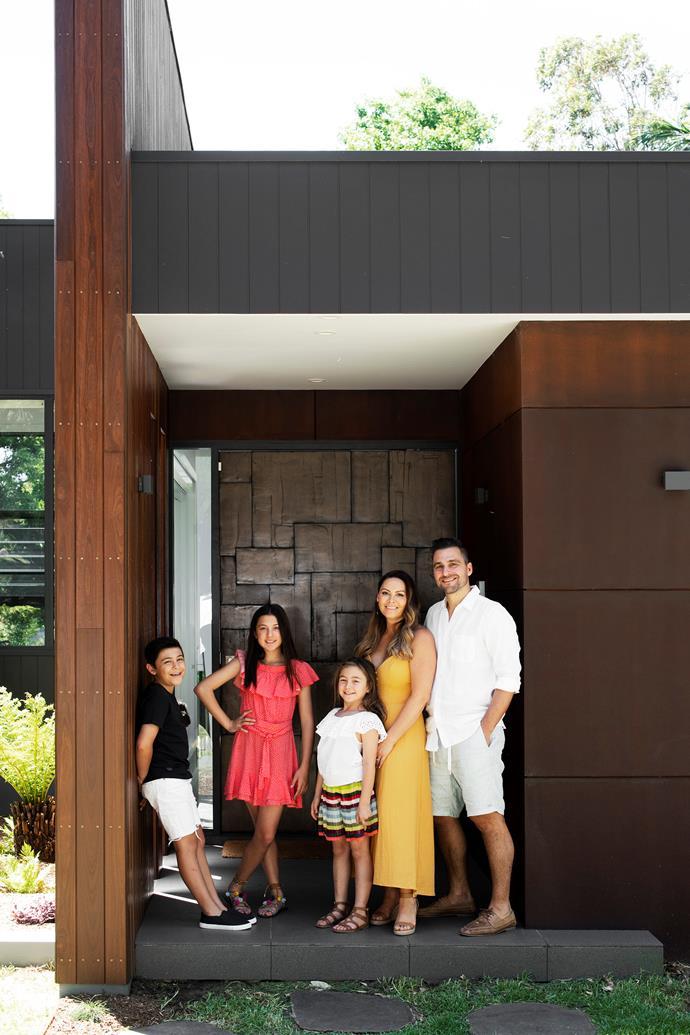 Maxsen, Amelia, Stella, Melanie and Frank outside the custom-made front door.
