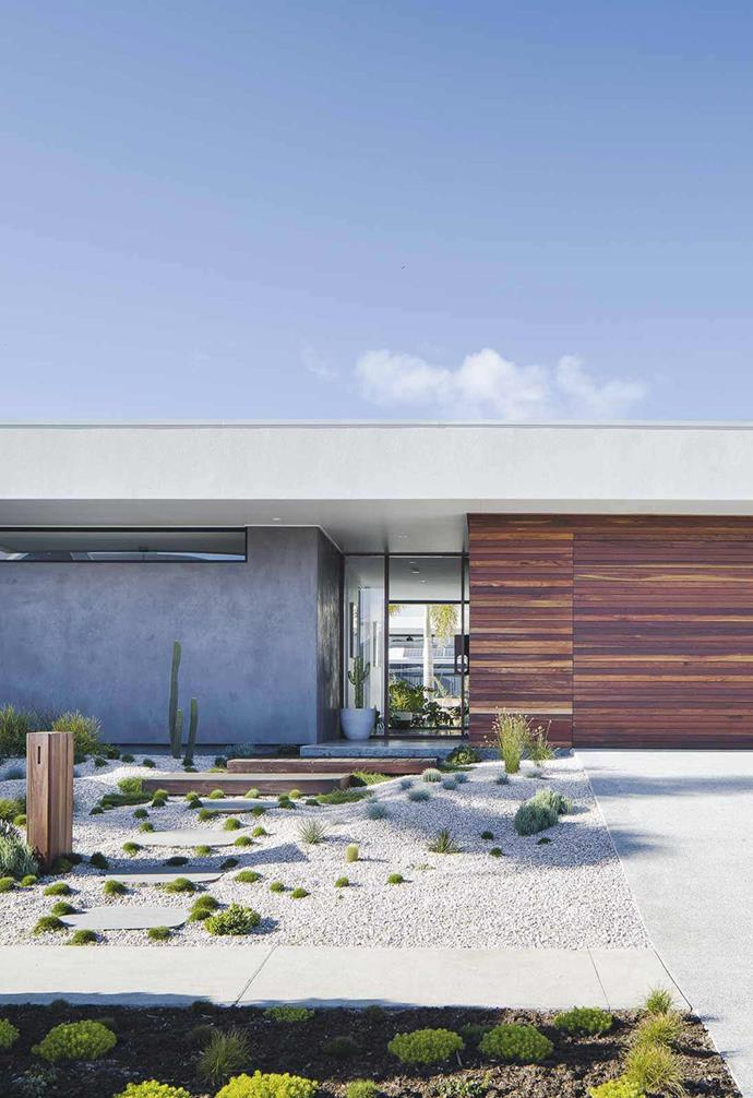 """Timber, concrete and glass come together to create a striking front facade for this [Palm Springs-inspired coastal home](https://www.homestolove.com.au/palm-springs-inspired-home-19646