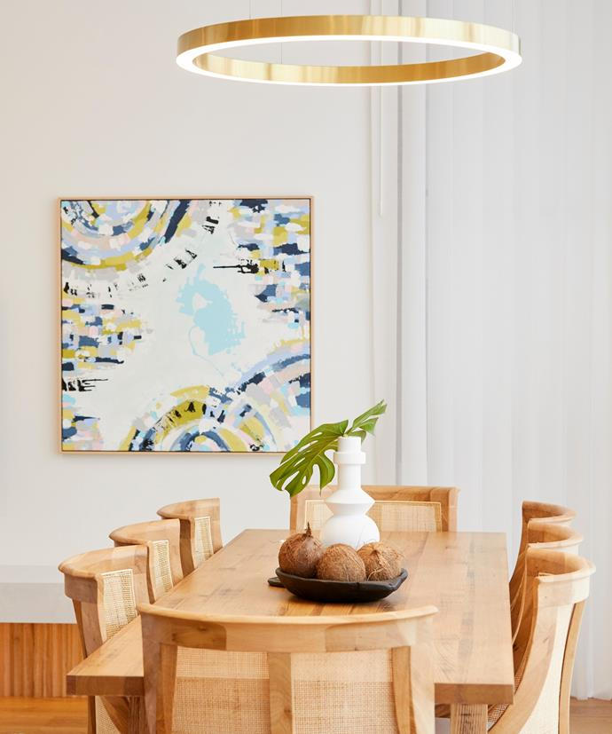 **Week 7, Dining Room** Featuring a stunning Hamptons-style timber table and chairs with a statement pendant suspending above, Luke and Jasmin's dining room feels warm and inviting - the ideal setting for relaxed family meals or entertaining guests.