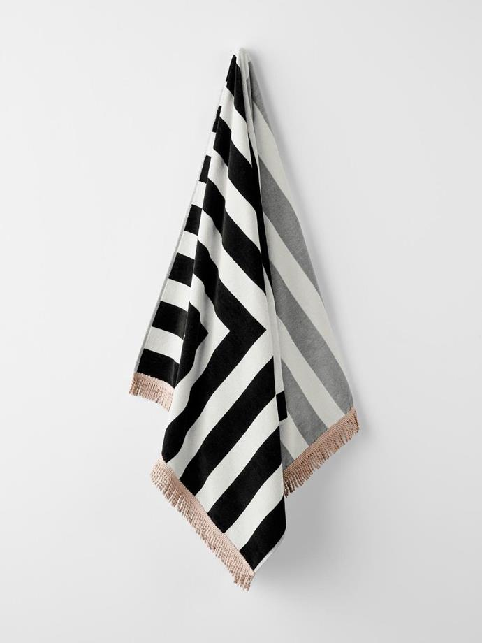 "Corner Stripe beach towel in Black, $49.95, [Aura Home](https://www.aurahome.com.au/corner-stripe-beach-towel-black|target=""_blank""|rel=""nofollow"")."