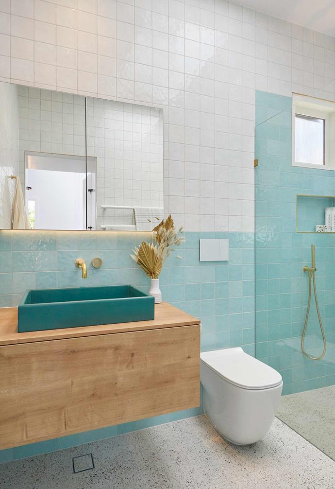 "**[Week 2, Guest Ensuite](https://www.homestolove.com.au/the-block-2020-guest-ensuite-reveals-21798|target=""_blank"")** Entering the Guest Ensuite through a hidden wardrobe door in the bedroom, Jimmy and Tam incorporated vibrant aqua tones for this space, which judge Darren Palmer described as similar to a ""public pool change room"" but with ""that retro, yesteryear, childhood charm."""
