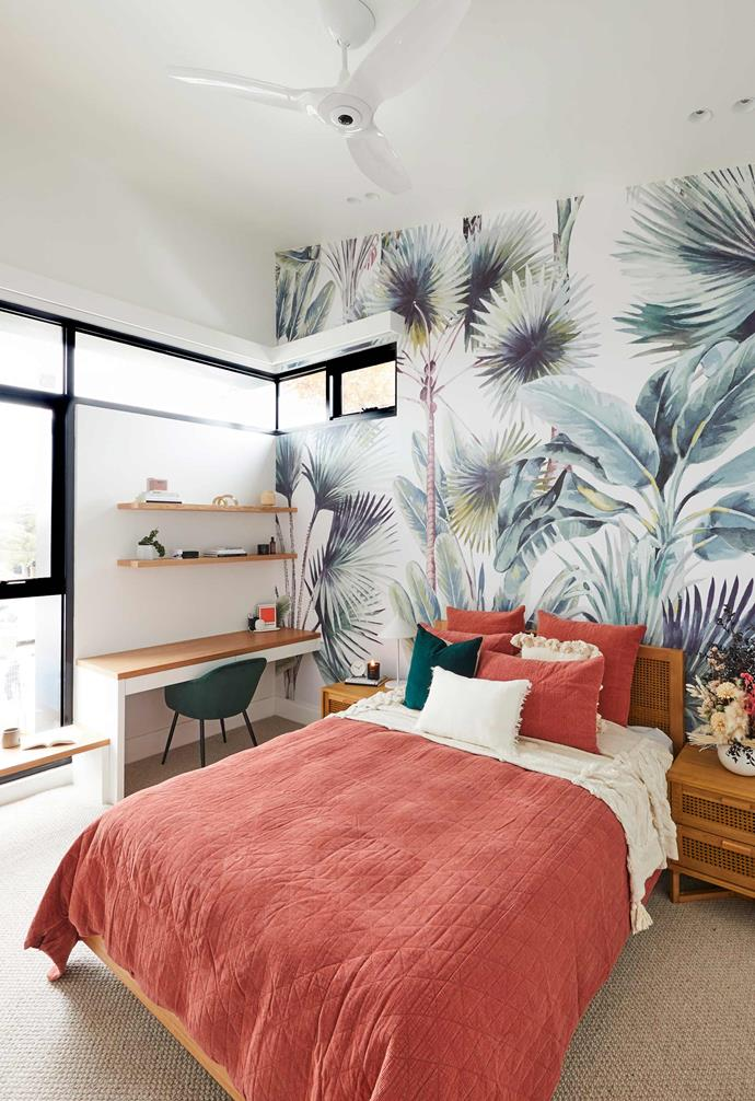 "**[Week 5, Upstairs Bedroom and Bathroom](https://www.homestolove.com.au/the-block-2020-upstairs-bedroom-and-bathroom-reveal-21860|target=""_blank"")** Continuing with their Palm Springs aesthetic, a tropical-inspired wallpaper is the crowning feature of the first of Jimmy and Tam's upstairs bedrooms. With generous windows and cool, coastal styling, Darren Palmer described the room as ""unbelievably colourful and bright and retro."""