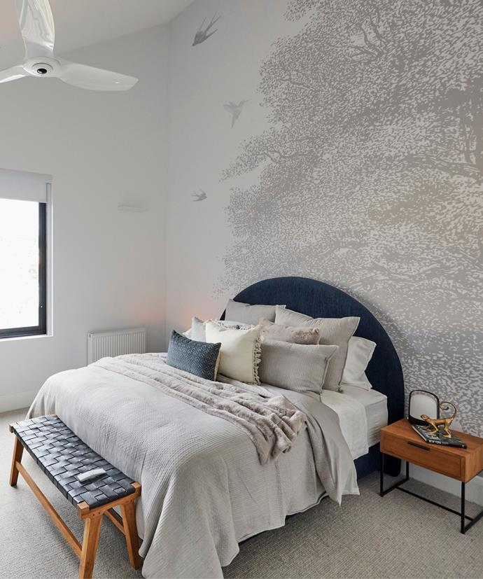 **Week 5, Upstairs Bedroom**  Sarah and George's lofty upstairs guest bedroom features sweeping, raked ceiling and an elegant Grafico wall mural that accentuates the space.