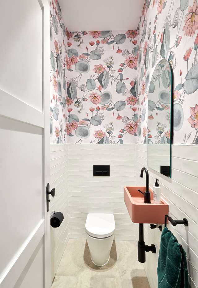 """**Week 9, Powder Room** Their """"sweet"""" power room with floral wallpaper and pink concrete sink was also pronounced """"faultless"""" by the judges."""