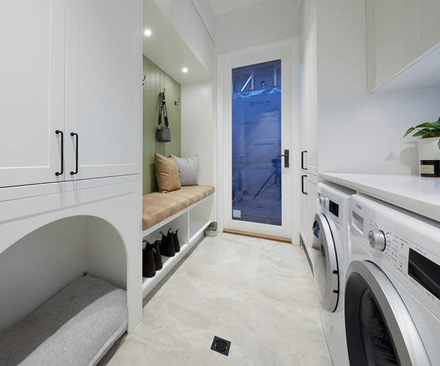**Week 9, Laundry** Sarah and George used a living prop - Foreman Dan's adorable Beagle - to present their laundry to the judges, showing off the built-in dog bed and mudroom functionality of their laundry space.