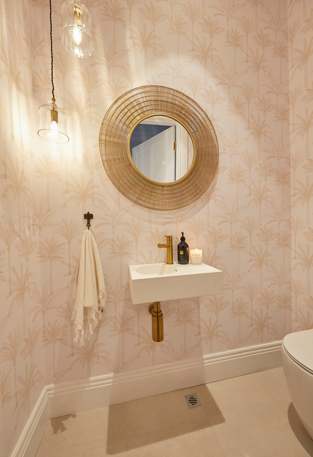 **Week 9, Powder Room** Their pretty powder room, with its pink palm-printed wallpaper and gold tapware, found the niche between contemporary and vintage style.