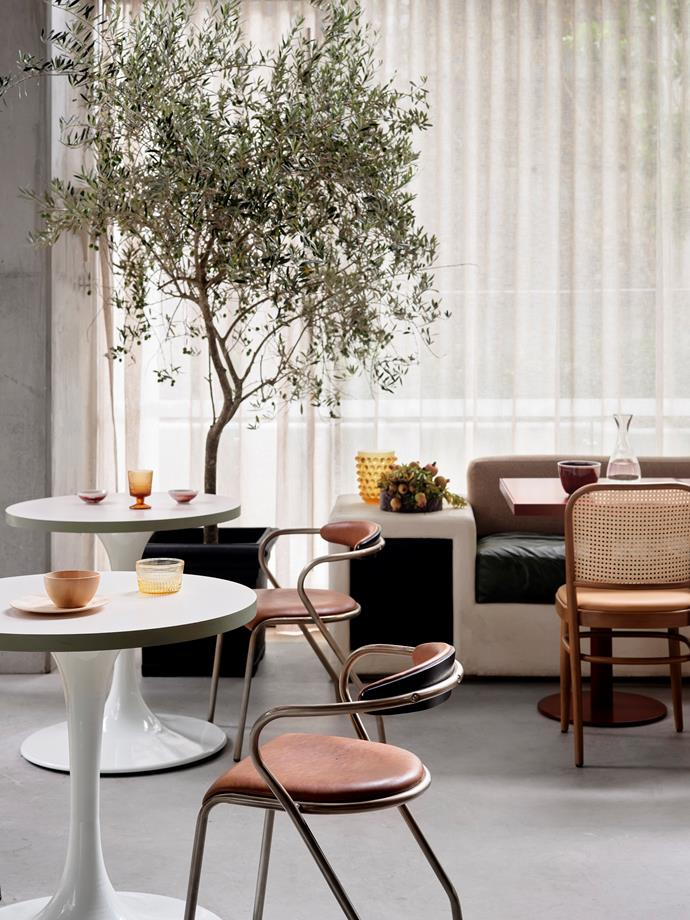 "Several seating options, including [bar stools](https://www.homestolove.com.au/best-bar-stools-19030|target=""_blank""), Bentwood chairs, benches, a sofa and banquette, have been employed to establish different dining zones within the space."