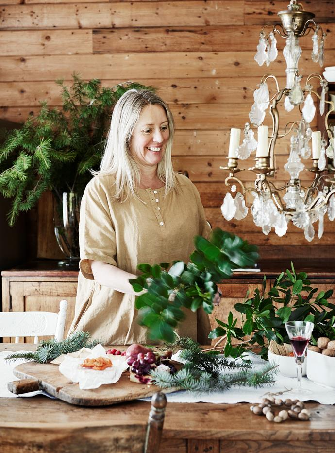 Helen decorating the dining table with foliage from her garden.