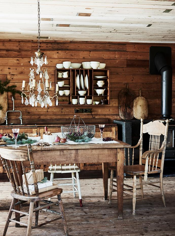 The kitchen and dining area was lined in old timber boards sourced by the owner Helen Curtis. The chandelier and table are French and the chairs are Australian antiques. You can find similar at Found in Daylesford.