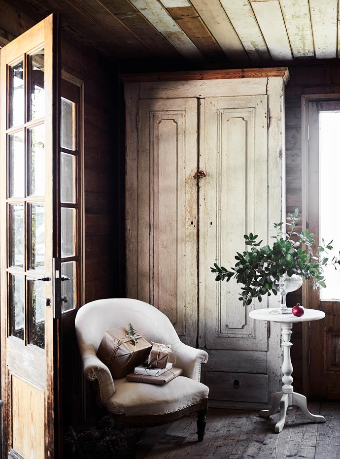 Helen uses an old armoire as a pantry.