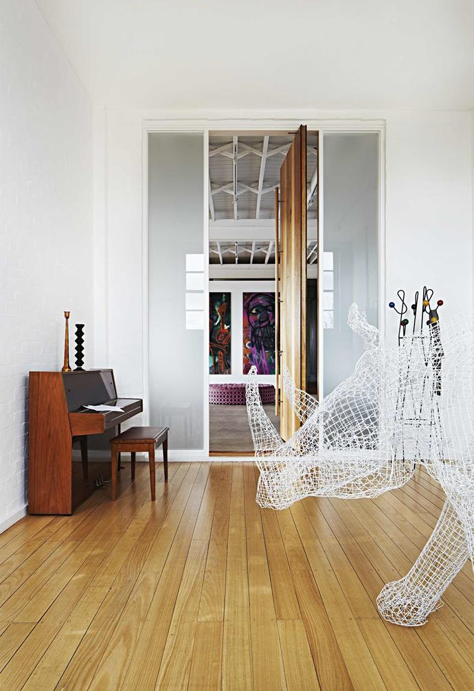 """**Standing guard** A giant wire rhinoceros sculpture greets visitors as they step from the lift into the fourth-floor apartment. But even he is dwarfed by this four-metre hardwood pivot [front door](https://www.homestolove.com.au/front-doors-australia-6476