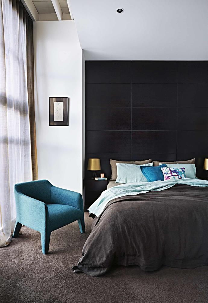 """**Moody hues** Pristine white walls and sea-green accents offset the [master bedroom's](https://www.homestolove.com.au/modern-bedroom-ideas-18706