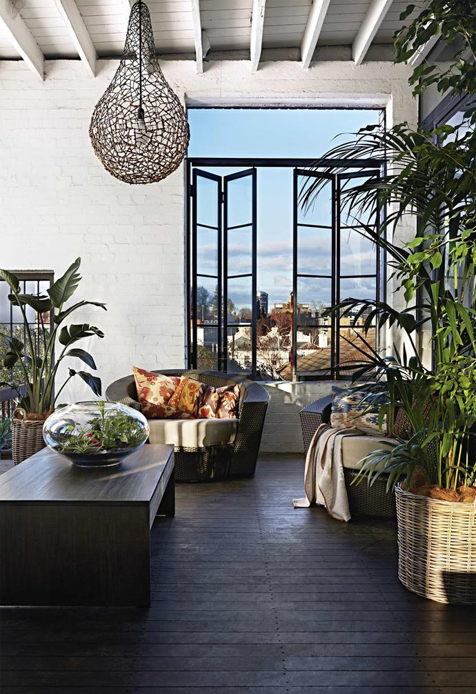 """**High-rise greenery** A late addition to the plans, this indoor deck connects the home to the outside all year round. Chairs strewn with cushions from [The Family Love Tree](https://www.thefamilylovetree.com.au/