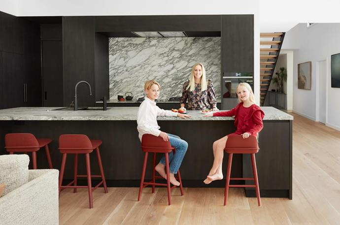 Siobhann with her children, Finn and Ailish. Navurban Ravenswood joinery designed Siobhann Studio and made by Portelli Joinery. Sirius rangehood and Gessi 'Just Pull Out' tap, both Winning Appliances. HydroTap Elite, Zip. Arabescato Corchia marble splashback and Viscount White granite benchtop, both CDK Stone. Muuto Nerd stools, Living Edge.