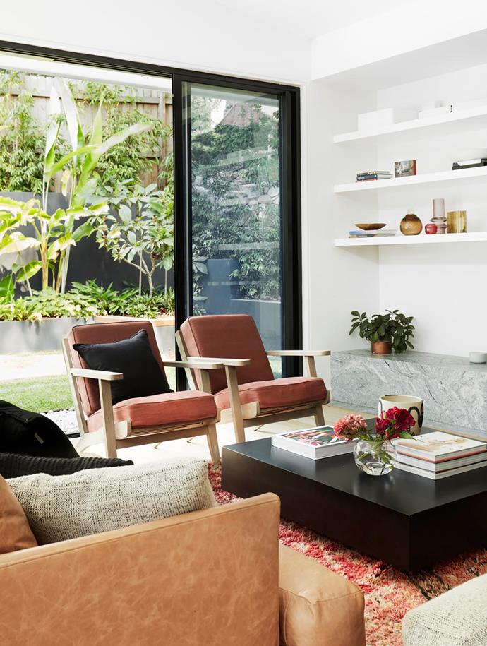 Fremont armchairs from Horgans, upholstered in Mokum Eternal Masala. Monaco coffee table, Coco Republic. Moroccan rug, Few & Far. Bowls by Tom Dixon. Artwork by Harley Manifold.
