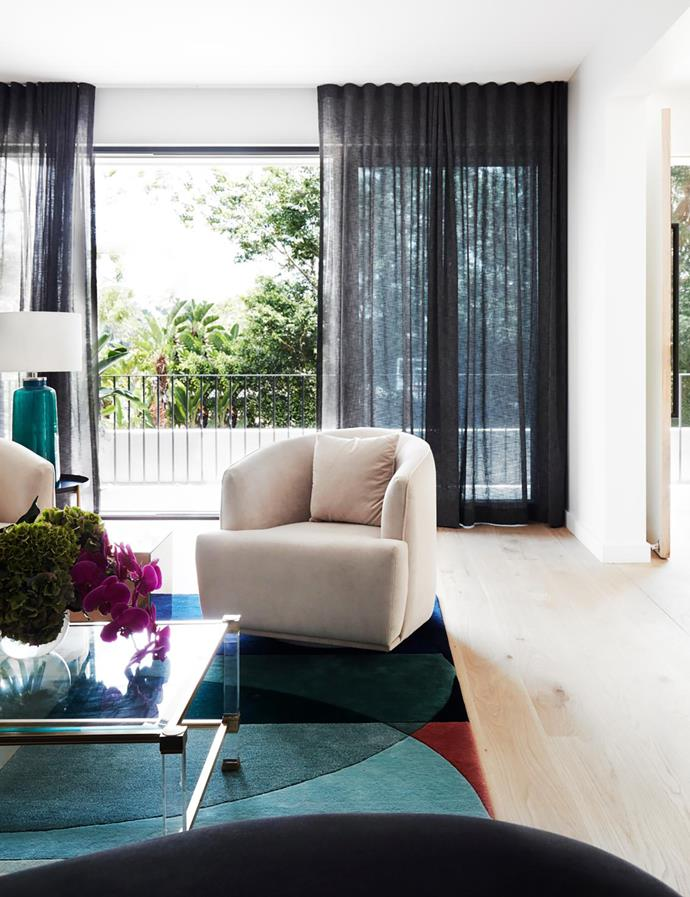 Ocean rug, Designer Rugs. Shoji curtains in Charcoal, Mokum. Table lamp, Few & Far. Pierre Vandel coffee table.