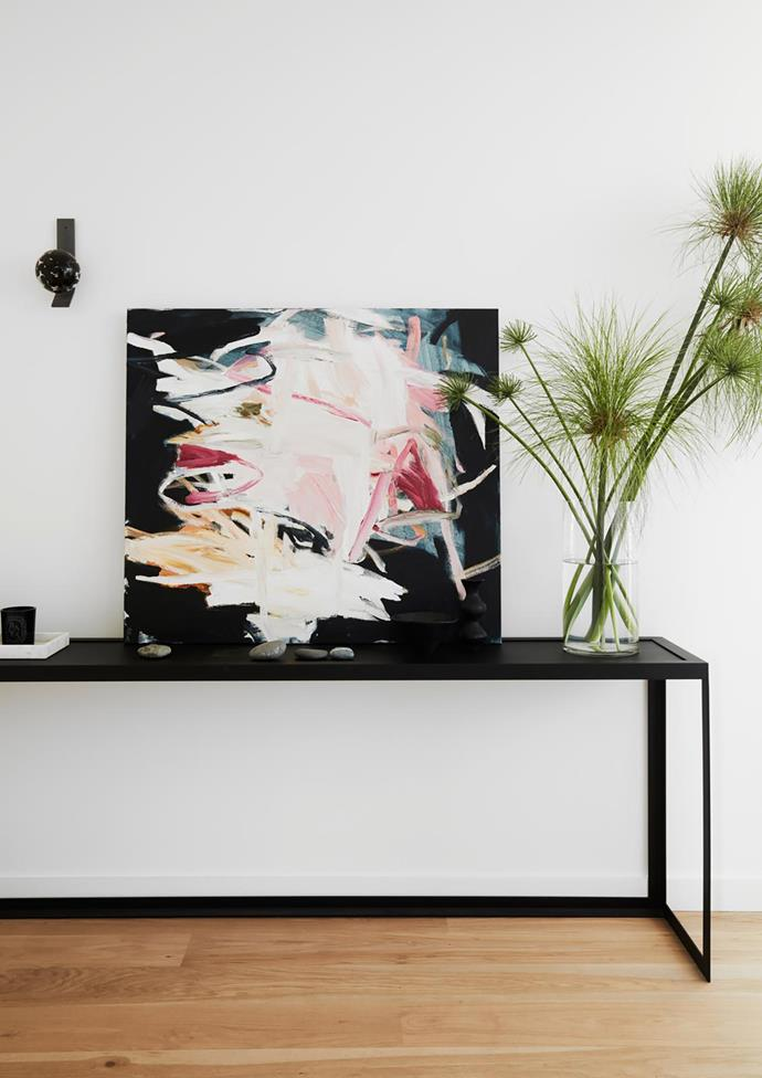 Above right Painting by Antonia Mrljak. Spoti wall sconce, Articolo Lighting. For similar console try Globe West