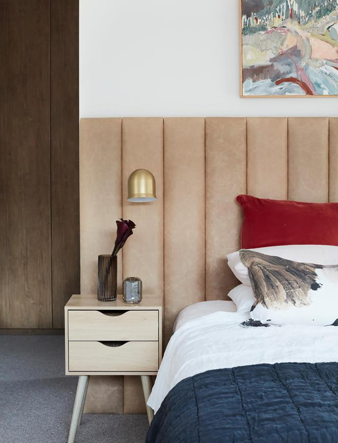 Side table, Kmart. Narciso wall light, LightCo. Custom bedhead, Siobhann Studio.