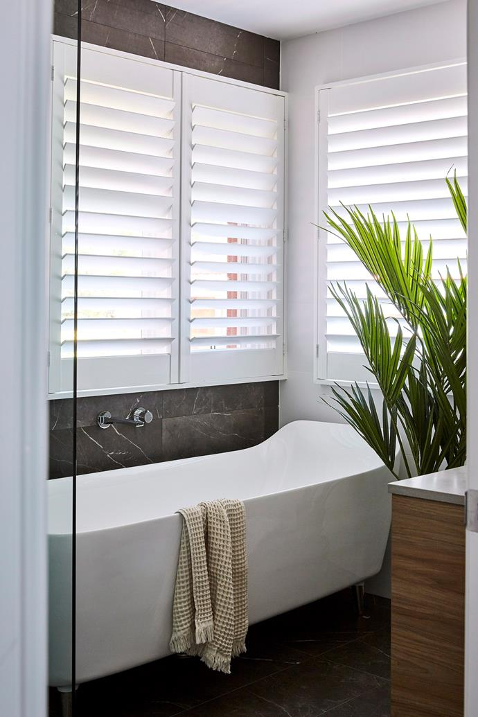 Simple updates like fresh, fluffy towels and an indoor plant can turn your bathroom into a relaxing retreat.