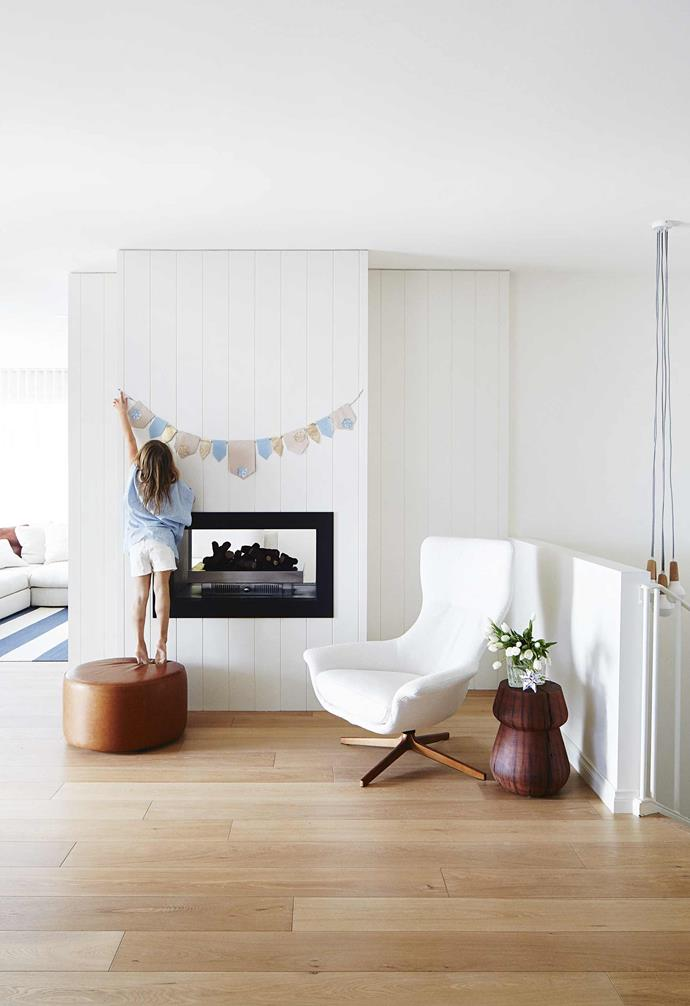 """**Living area** Lilah is keen to get into the spirit of the season, hanging up this handmade bunting above the fireplace. A 'Seymour' chair from [King Living](https://www.kingliving.com.au/