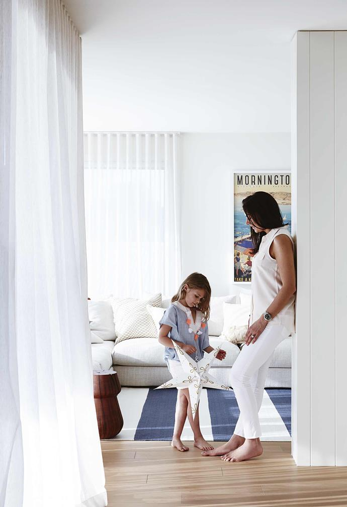 """**Coastal calm** To bring that sunny and relaxed feel to your place, you can't go past pale timber floorboards, white panelled walls and a nautical blue-and-white striped rug (this one's from [Armadillo&Co](https://usa.armadillo-co.com/