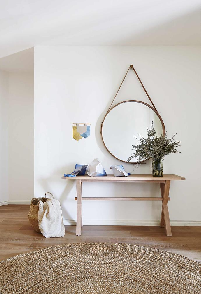 """**Entry** The Bespokery bonbons make a festive welcome on a console table from [Jardan](https://www.jardan.com.au/