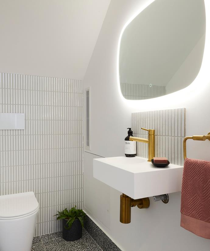 "**[Week 9, Powder Room](|target=""_blank"")** Also concealed behind a secret door, their simple powder room featured white kit-kat wall tiles, terrazzo floor tile, brass tapware and quirky mirror, to fit in with the modern-retro aesthetic of their home."