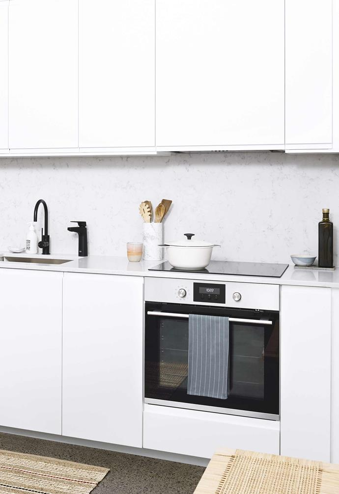 "People often assume that a [flat-pack kitchen](https://www.homestolove.com.au/ikea-flatpack-kitchen-styling-ideas-1696|target=""_blank"") is a fixed-format option, but that's not the case. Depending on which system you choose, the format of the cupboards and drawers can be changed, not to mention custom panels can be created; for example, a panel above the fridge, covering the excess space people often have if their appliances were bought for another area."