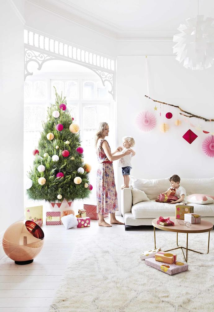 "**Home sweet home** The [all-white canvas](https://www.homestolove.com.au/all-white-interior-design-trend-19968|target=""_blank"") provides the perfect neutral background for a colourful Christmas and home decor."