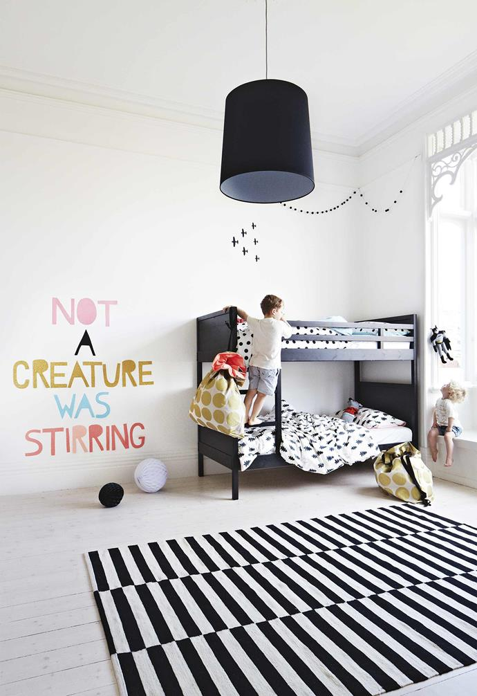 **Harper's bedroom** This room features a Scandi take on black and white with bold pattern. The bunk bed and striped rug are both from Ikea.
