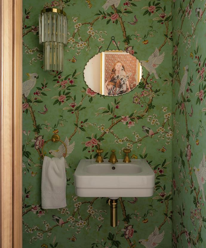 The powder room is lined in a joyful wallpaper, Brunschwig & Fils 'Kanchou' in Verdigris. J.T. Kalmar wall sconce. Client's own mirror.
