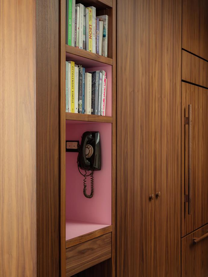 A functioning wall telephone offers low-tech charm. Abet Laminati 830 laminate in Rosa Crazy Horse in the phone nook.