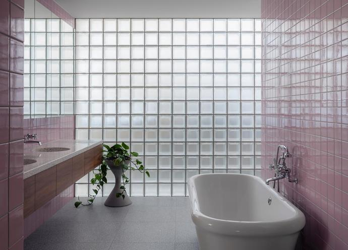 A wall of glass blocks provides privacy in the master ensuite and also admits abundant natural light. The Water Monopoly 'Rockwell' bath and tapware from The English Tapware Company. Swisspearl 'Spindel' planter pot from Robert Plumb.