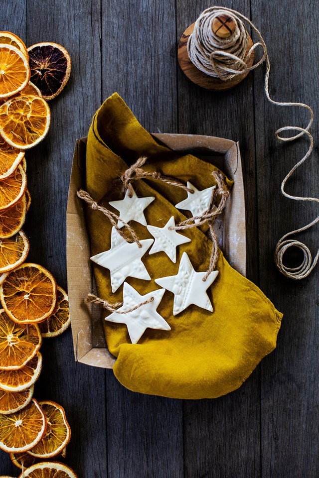 """""""Dehydrated oranges make a beautiful golden garland that is very simple to make and plastic free,"""" says stylist Kara Rosenlund."""