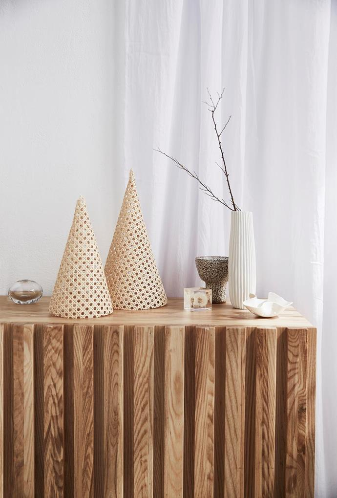 "[Mini Christmas trees](https://www.homestolove.com.au/mini-christmas-tree-ideas-20871|target=""_blank"") are a simple and neat way to introduce the festive spirit to your tables. Story: Real Living"