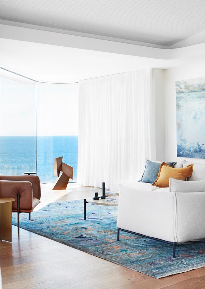 With large expanses of glass looking out to the Pacific's vanishing point, this Sydney home conceived by Luigi Roselli Architects and Alwill Interiors ushers the sea inside thanks to contemporary P&O-style curves 