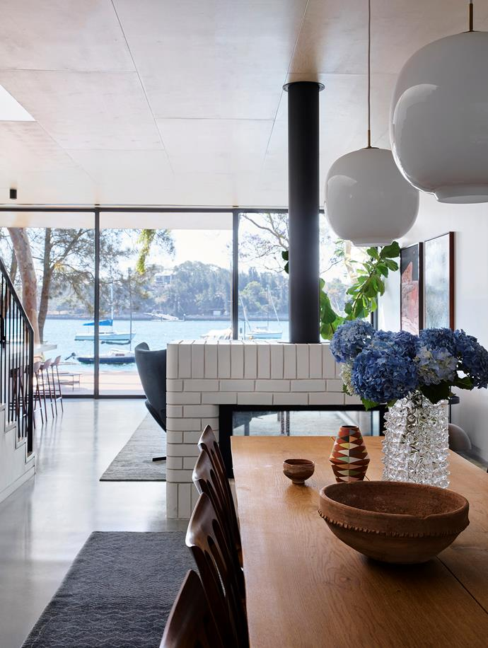 Though the peaceful, natural surrounds of sea and mature trees may soak up the limelight on this property, with an interiors scheme by Juliette Arent and Sarah-Jane Pyke, this home's statement furniture, Australian art-covered walls and warm palette light up the everyday lives of its inhabitants