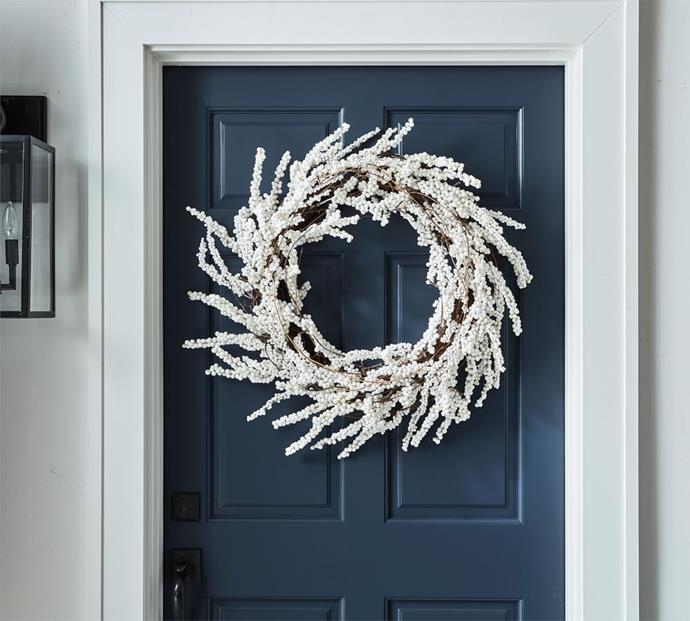 "Pre-Lit Faux White Berry 71 cm Wreath, $229, [Pottery Barn](https://www.potterybarn.com.au/pre-lit-faux-white-berry-wreath|target=""_blank""