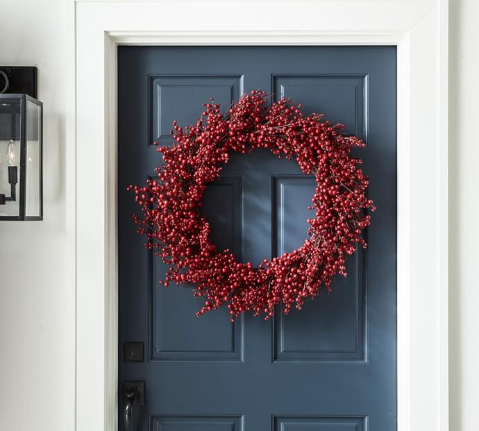 "Red Berry Wreath, $229, [Pottery Barn](https://www.potterybarn.com.au/faux-red-berry-wreath|target=""_blank""